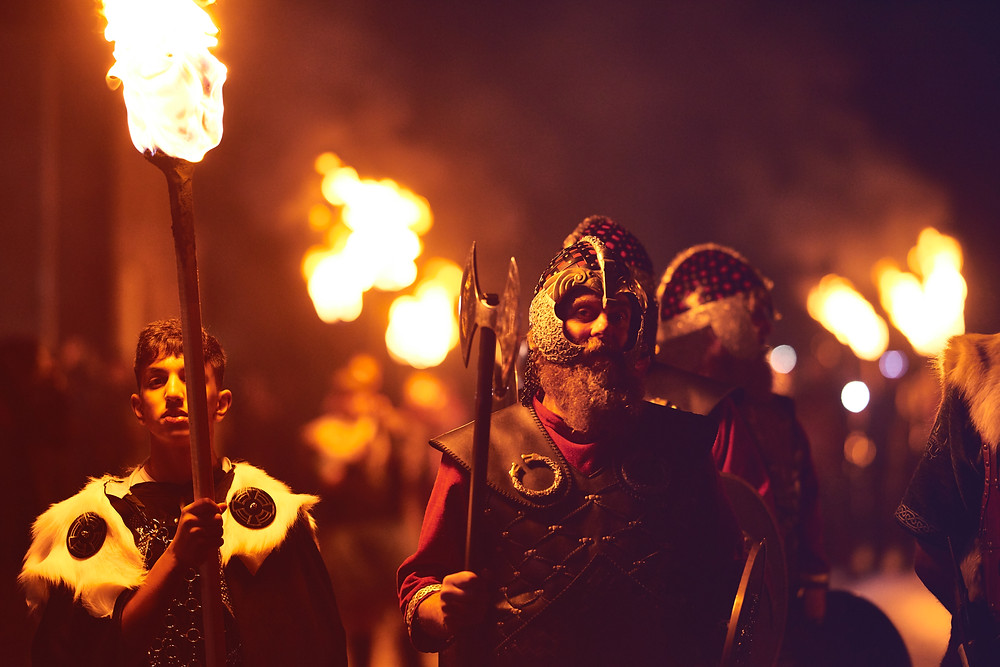 Men in Viking garb lead a procession of costumed men at Up Helly Aa.  Picture us curtesy of Visit Scotland via Zachary Burns., CTA.