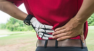 Golfer suffering with low back injury