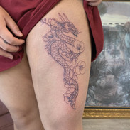 dragon and flowers tattoo