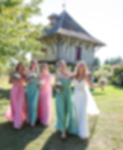 a bride and her bridesmaids laughing at a chateau in dorsogne south west france