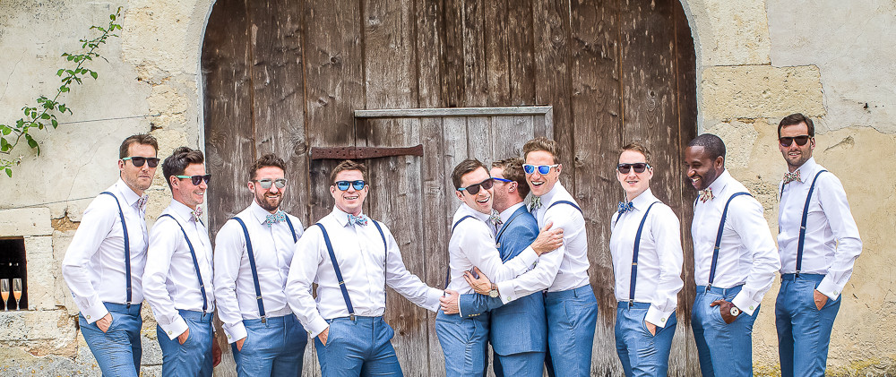 Groom laughing with his freinds for a  photographer in dordogne