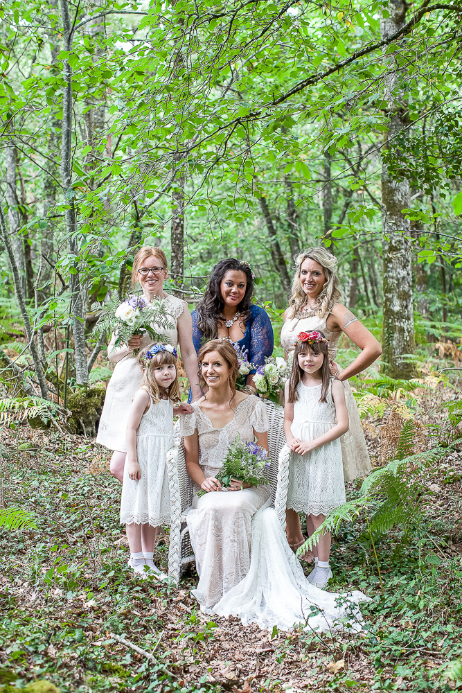 Bride and her maids in a forest setting in rural france