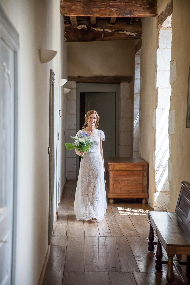 Bride walking down a corridor at a wedding in dordogne