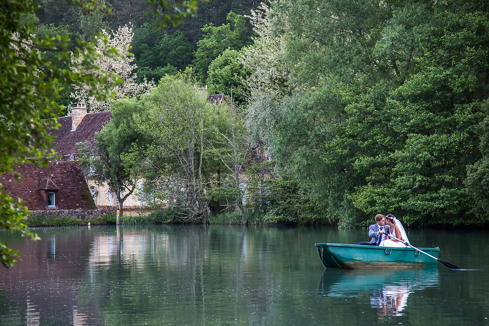 bride and groom in boat at forge du roy