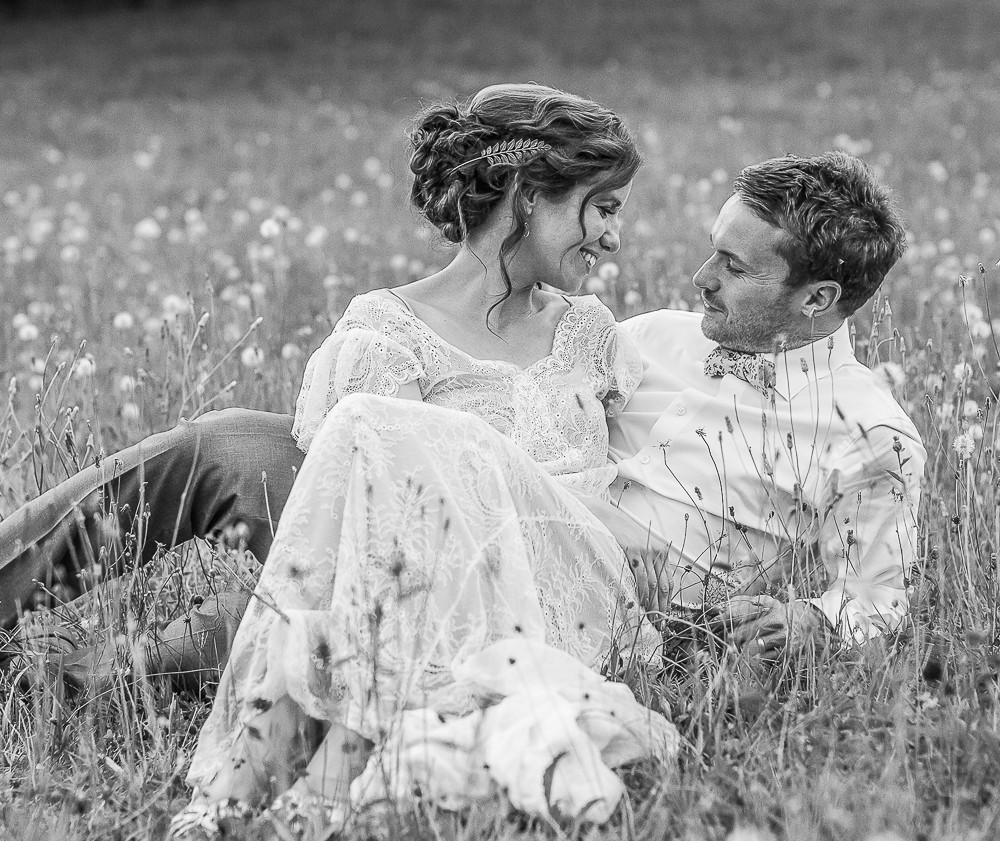 a romantic moment for this couple in a field in france