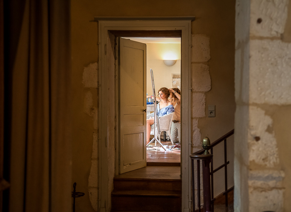 Bride getting ready at a chateau wedding photographer in dordogne