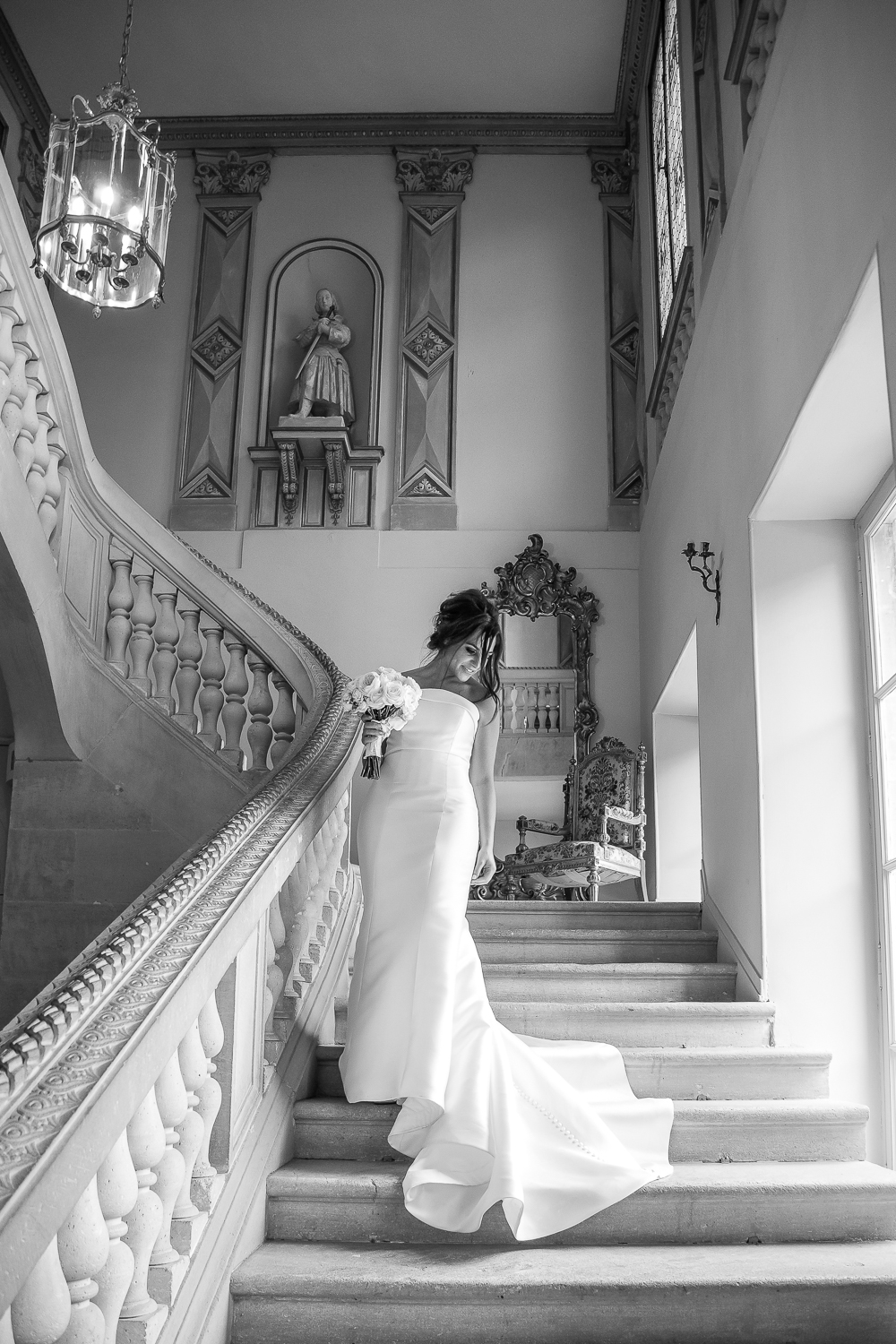 bride on the staircase at Chateau Durantie