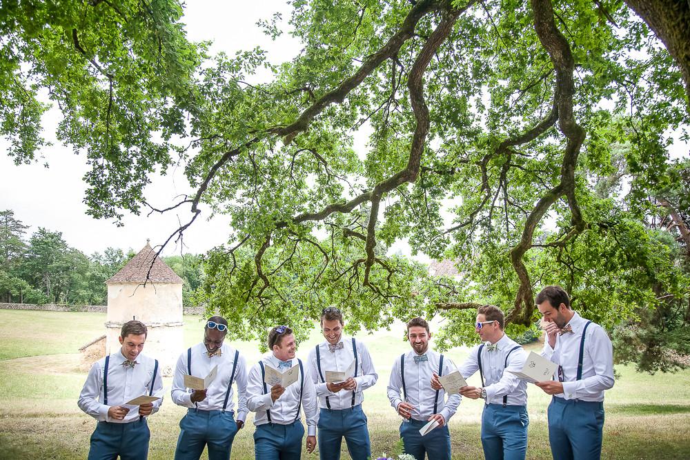 groomsmen laughing at a wedding