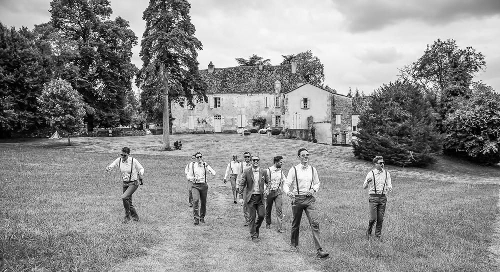 Groom walking for a wedding photographer in dordogne