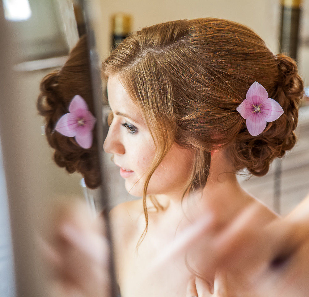 Close up of bride with flower in her hair at a wedding in dordogne