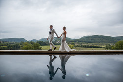 Bride and groom walking in Dordogne