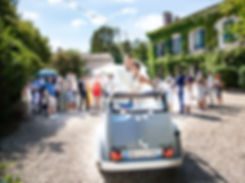 a bride and groom in a wedding car at a chateau in dordogne south west france a