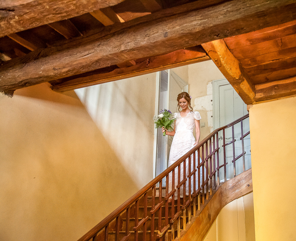 Bride coming downstairs at a wedding in dordogne France
