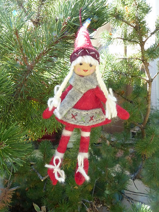 Nordic girl ornament in tree