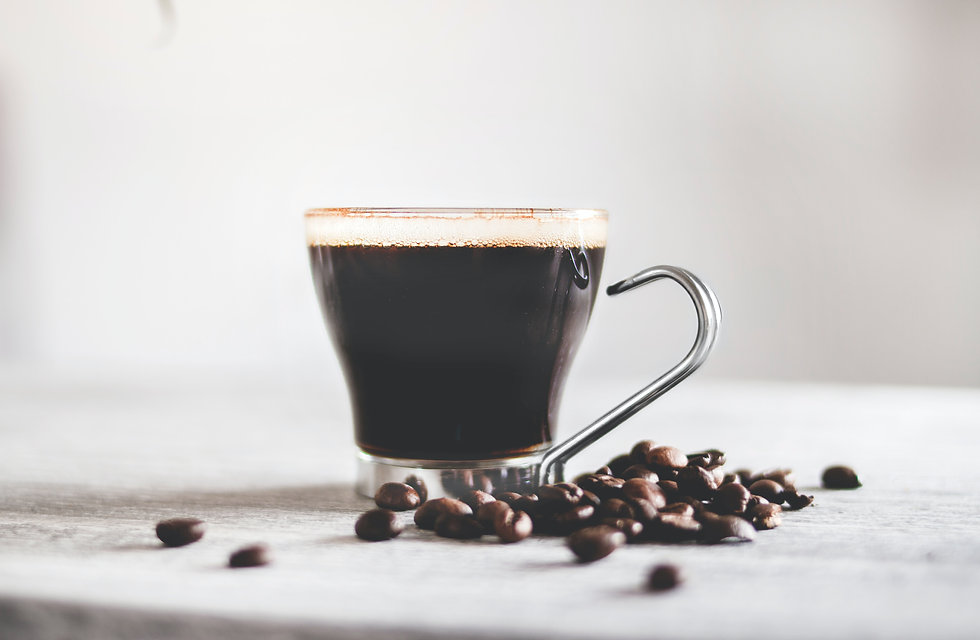 cup-of-black-coffee-and-coffee-beans-977