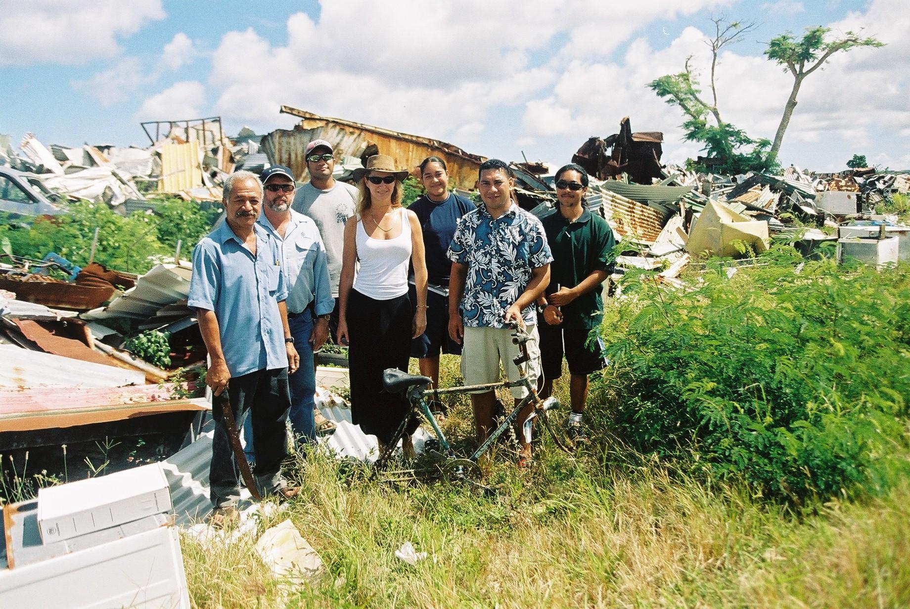 Nuie, petra, Nuieans and scrap metal in background.JPG