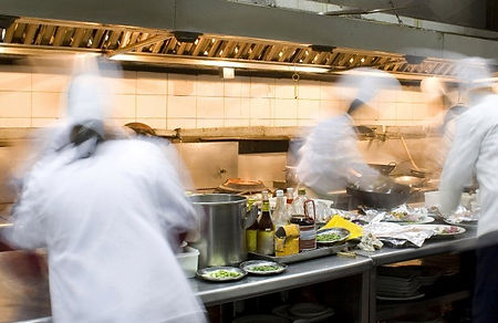 Talented chefs cooking inside our busy kitchen. Art of Food. Wok cooking. Flavourful dishes, freshly made with quality ingredients.