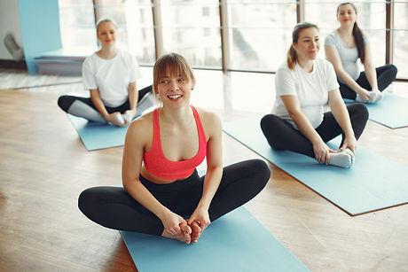a-group-of-women-doing-yoga-3984338.jpg
