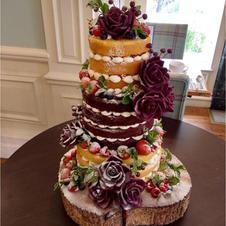 Burgundy sugar flowers on our cake Sophie