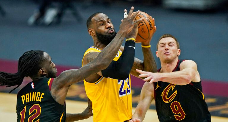LeBron drops 46 points in an edgy win over Cleveland, 115-108