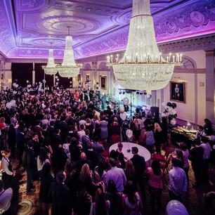 corporate event, chandelier, people, speech, stage
