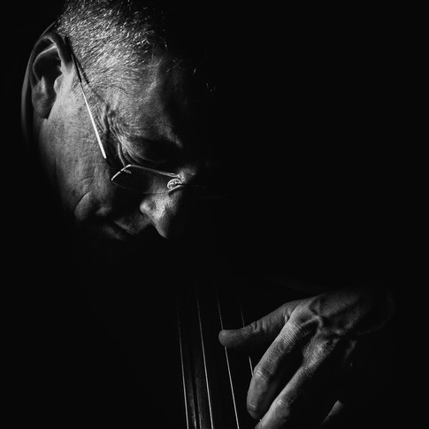 double bass player black and white closeup