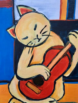 Kitty Plays Guitar (who knew?)
