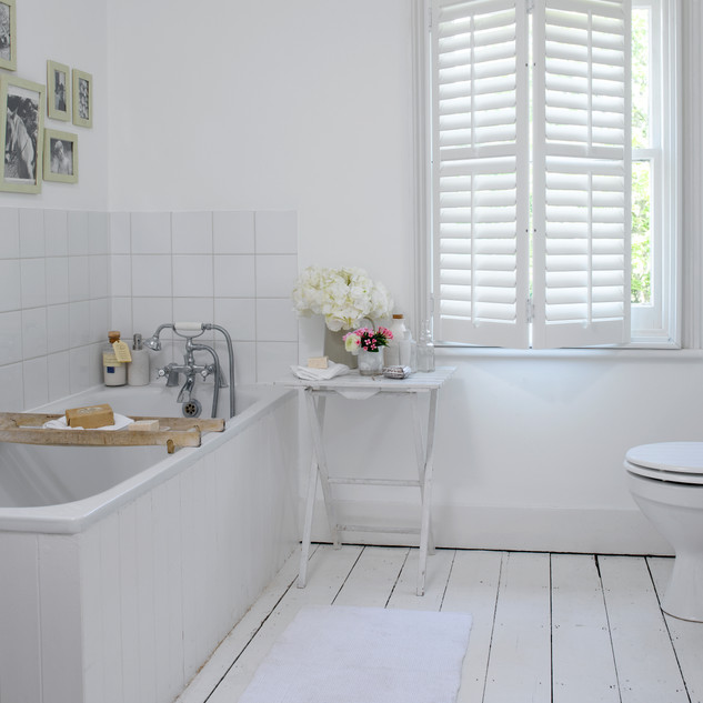 White Bathroom Shutters - Hybrawood.jpg
