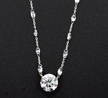 Platinum Necklace with one round brilliant-cut center diamond and briolette-cut diamonds