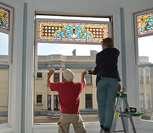 Installation of repaired Victorian antique stained glass window