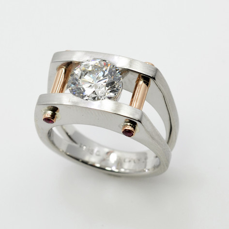 Men's Platinum Ring with a center diamond and cabochon rubies set on 18K rose gold posts