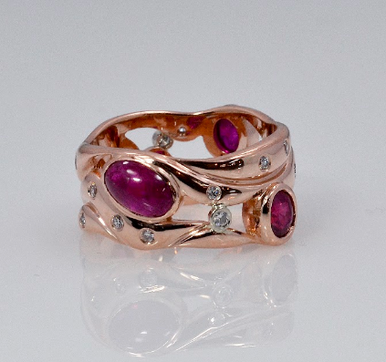 Rose gold, Cabachon ruby and diamond ring