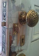 antique door hardware installation into a restored door