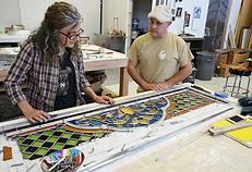 re-leading and replacing damaged sections of stained glass