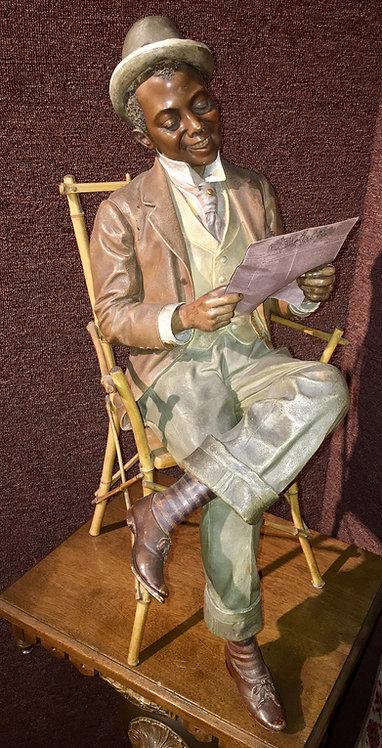 DANDY READING NEWSPAPER BY GOLDSCHEIDER