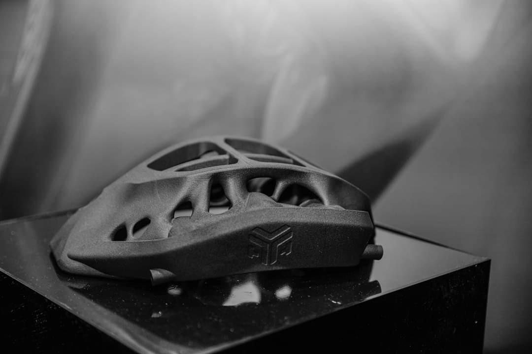 Topology optimized brake caliper