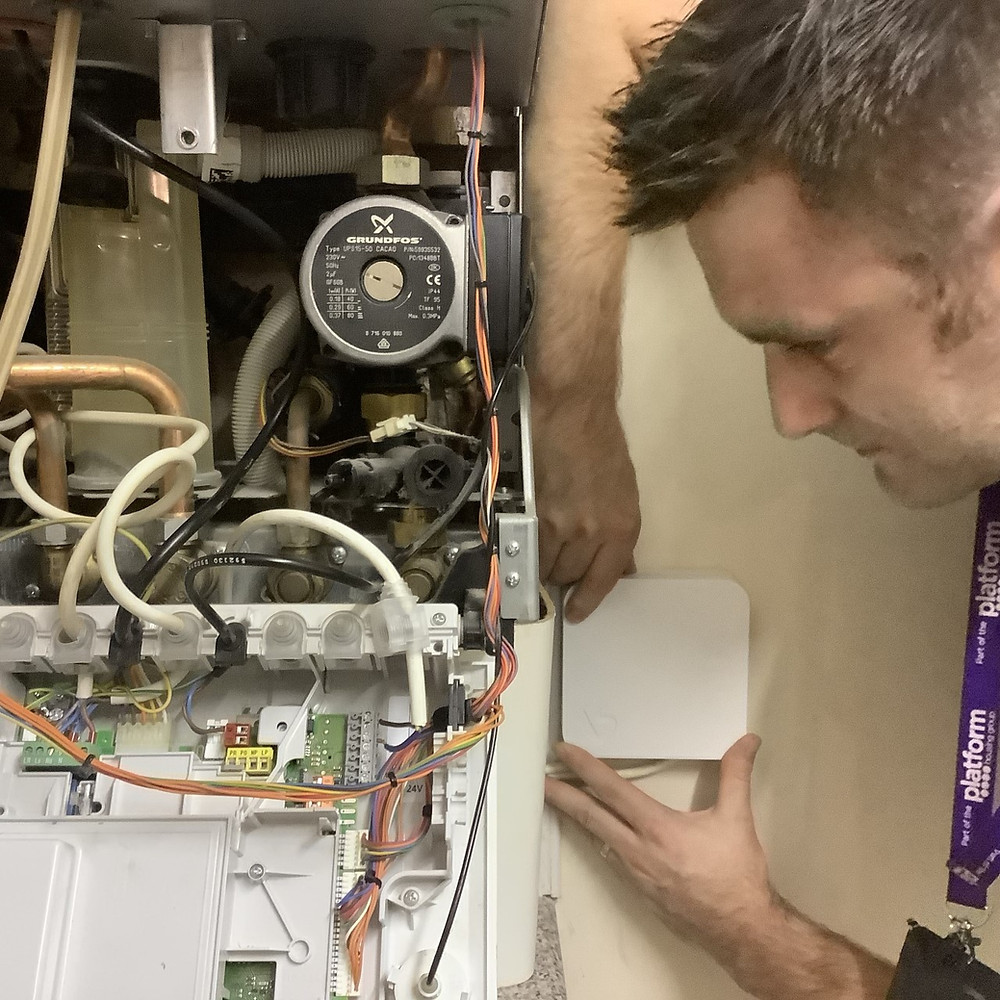 engineer_testing_iot_device_on_boiler