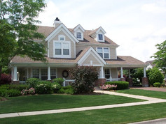 Front Exterior via Old Walnut Circle, including Wrap Around Covered Porch, Circular Driveway and Portico