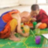 Monk Children In Art Lesson Blowing Bubbles