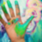 Artist hand covered in paint