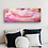 Pink and orange sky painting on bedroom wall by Emily Louise Heard