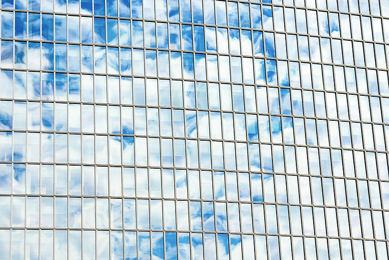 Clouds Reflected on Windows