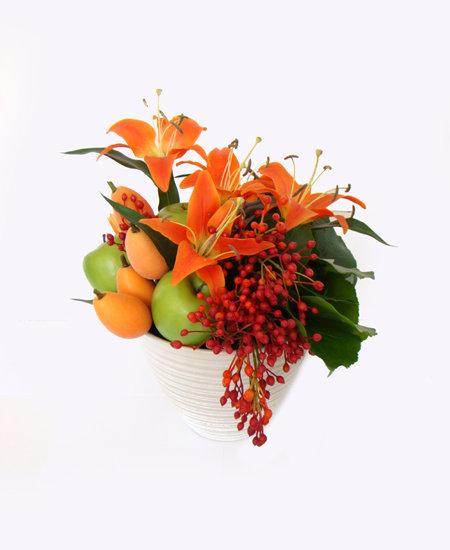 Arranjo frutas, lírios
