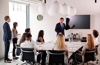 mature-businessman-addressing-group-meet