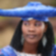 African woman blue hat