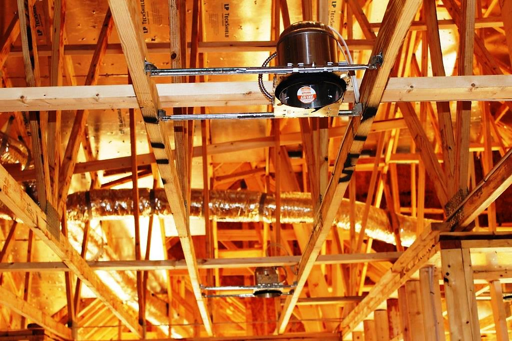 house construction project with wood beams and light fixture