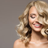 Blonde woman with curly beautiful hair s