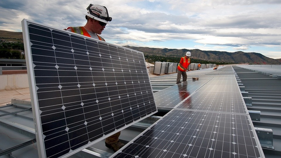 Commercial solar installation by employees