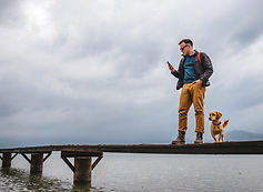man walking on dock with dog