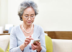 woman texting appointment reminders on celular device
